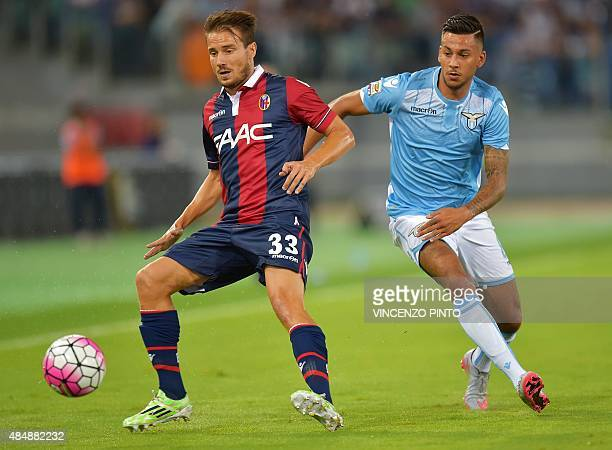 Bologna's midfielder from Italy Matteo Brighi controls the ball next to Lazio's forward from Netherlands Ricardo Kishna during the Italian Serie A...