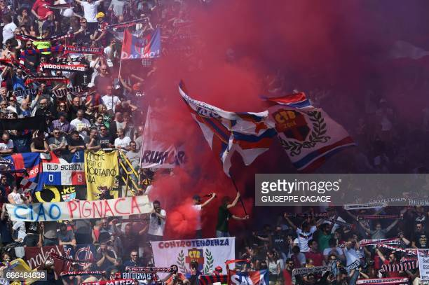 Bologna's supporters light smoke bomb during the Italian Serie A football match Bologna vs AS Roma at Dall'Ara Stadium in Bologna on April 9 2017 /...