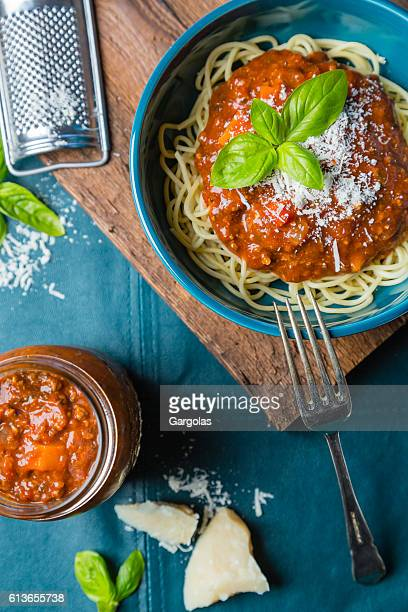 Bolognese spaghetti with cheese and basil