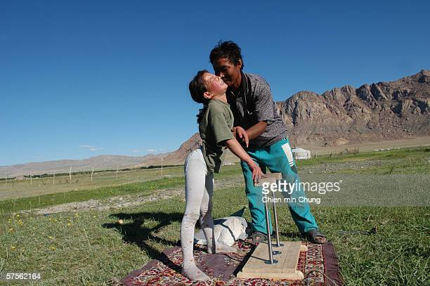 Bolor grimaces in pain as her spine locked in position and could not straighten during practice at he family farm on July 5 2005 in Khovd Mongolia