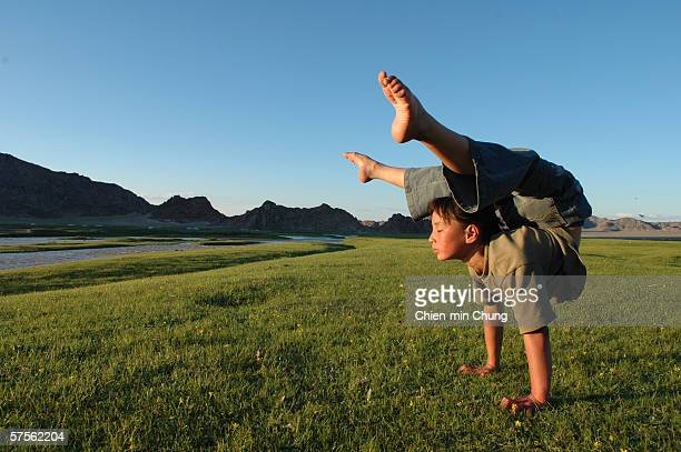 Bolor stretching during her daily practice in a field on July 6 2005 in Khovd Mongolia