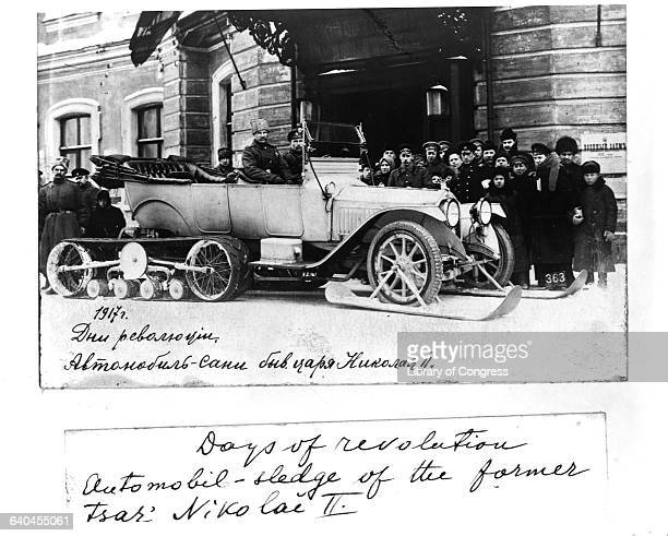 Bolshevik soldiers gather around a car belonging to former Tsar Nicholas II soon after the Revolution of 1917 and Nicholas' abdication The car likely...