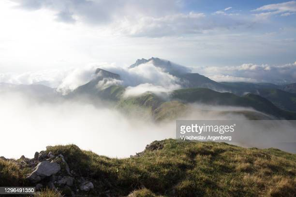 bolshoy tkhach in clouds, mountain landscape, adygea - argenberg stock pictures, royalty-free photos & images
