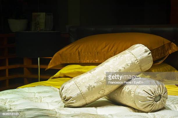 Bolster Pillows On Bed At Home