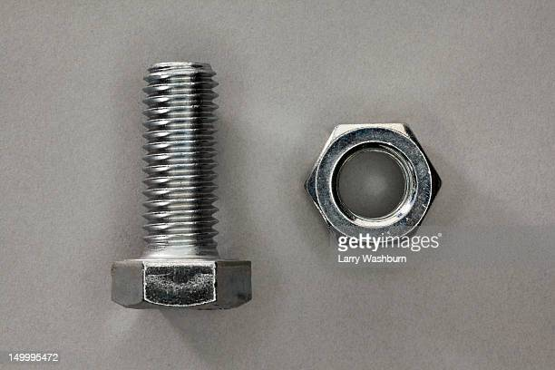 a bolt and a nut - things that go together stock photos and pictures