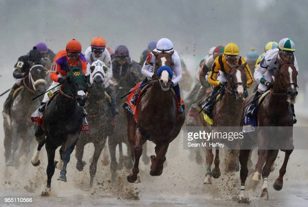 Bolt d'Oro ridden by jockey Victor Espinoza Promises Fulfilled ridden by jockey Corey Lanerie and Justify ridden by jockey Mike Smith lead the field...