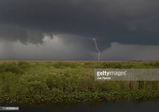 Bolt of lightening is seen over the Florida Everglades on May 15, 2019 in Everglades and Francis S. Taylor Wildlife Management Area, Florida....