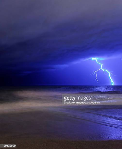 A bolt of lightning from an approaching storm at the beach in Miramar, Argentina.