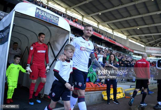Bolton captain David Wheater leads his team out ahead of the Sky Bet Championship match between Bolton Wanderers and Ipswich Town at Macron Stadium...