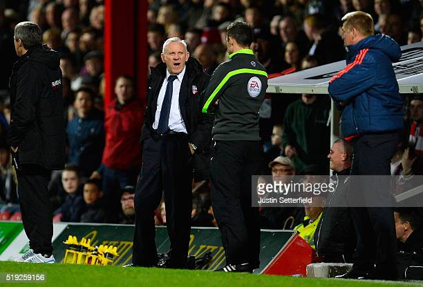 Bolton Coach Peter Reid argues with the 4th official during the Sky Bet Championship match between Brentford and Bolton Wanderers on April 5 2016 in...