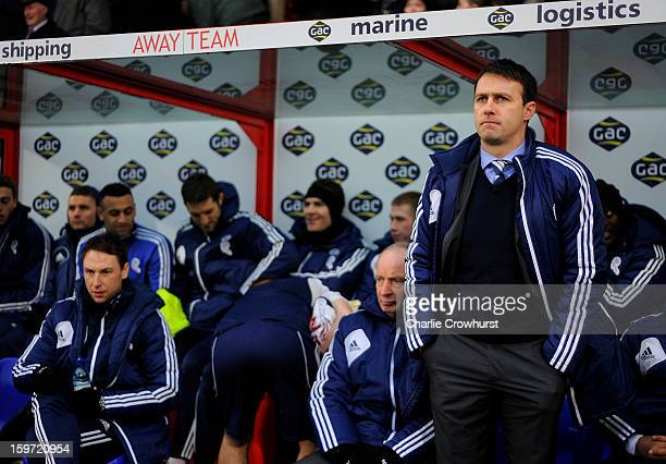 Bolton manager Dougie Freedman stands in the dugout during the npower Championship match between Crystal Palace and Bolton at Selhurst Park on...