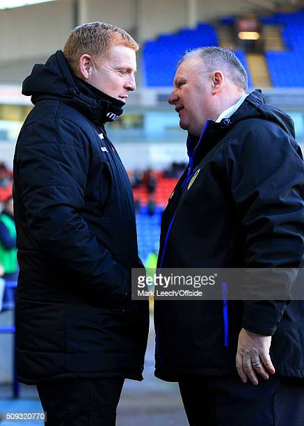Bolton manager Neil Lennon speaks to Leeds manager Steve Evans before the Emirates FA Cup Fourth Round match between Bolton Wanderers and Leeds...