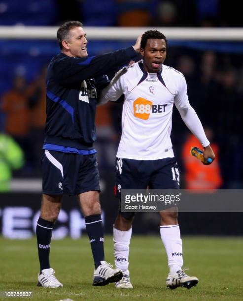 Bolton manager Owen Coyle celebrates with Daniel Sturridge after the Barclays Premier League match between Bolton Wanderers and Wolverhampton...