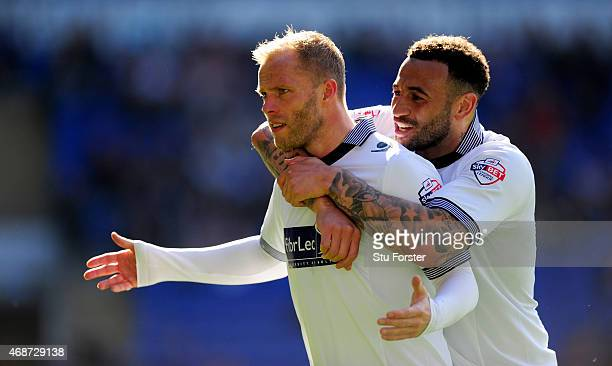 Bolton players Eidur Gudjohnsen and Craig Davies celebrate the first Bolton goal during the Sky Bet Championship match between Cardiff City and...