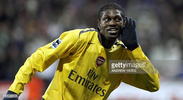 Arsenal's Emmanuel Adebayor celebrates scoring during their FA Cup fourth round reply football match against Bolton at the Reebok Stadium Bolton...