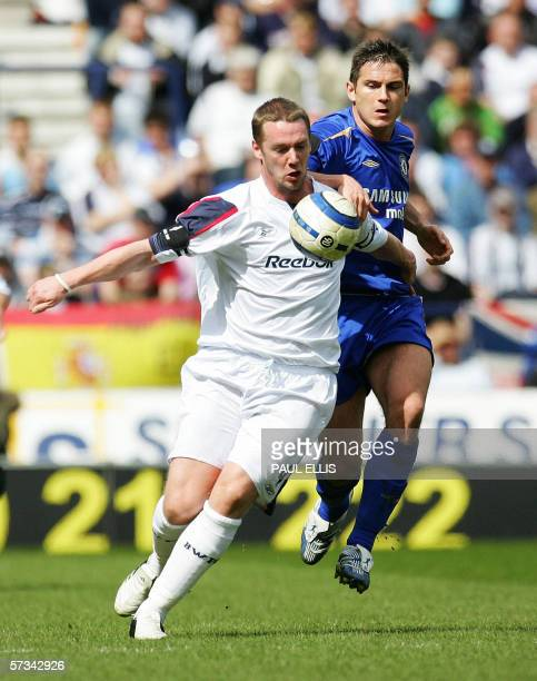 Bolton, UNITED KINGDOM: Bolton Wanderers' Kevin Nolan holds off Chelsea's Frank Lampard during their English Premiership football match at The Reebok...