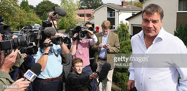 Bolton Wanderers' manager Sam Allardyce speaks to reporters as he leaves his home in Bolton northwestern Britain 20 September 2006 the morning after...
