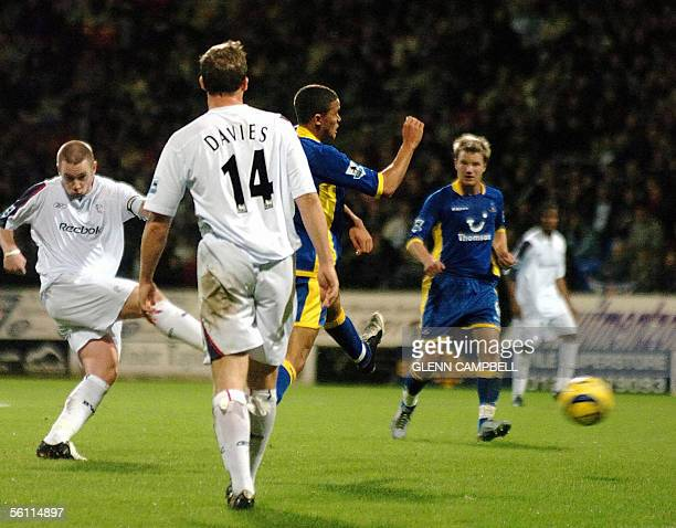 Bolton Wanderers's Kevin Nolan shoots at goal to give his team a 10 lead in the English Premiership match against Tottenham Hotspur at the Reebok...