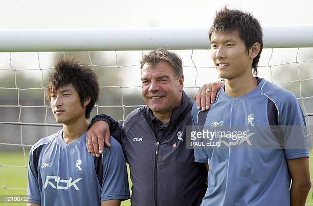 Chinese footballer Yang Chagpeng poses with Bolton Wanderers manager Sam Allardyce and team mate Zhou Liao as they takes part in an academy training...