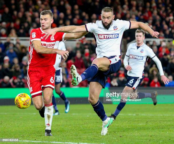 Bolton Wanderers' Aaron Wilbraham can't quite connect with a cross under pressure from Middlesbrough's Ben Gibson during the Sky Bet Championship...