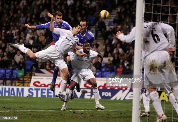 Bolton Wanderer's Abdoulaye Faye and Tal Ben Haim holds off Chelsea's John Terry and Andriy Shevchenko