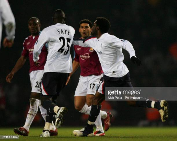Bolton Wanderer's Abdoulaye Faye is held back by teammate Jay Jay Okocha from West Ham United's Hayden Mullins during the FA Cup fifth round replay...