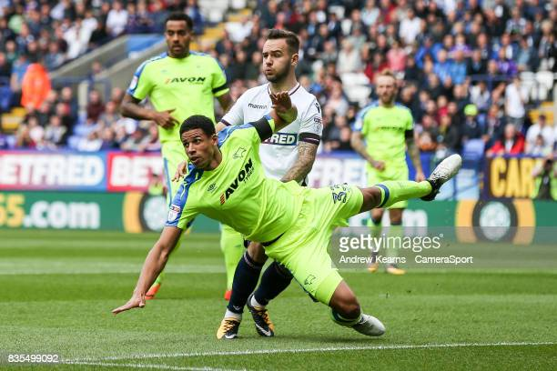 Bolton Wanderers' Adam Armstrong competing with Derby County's Curtis Davies during the Sky Bet Championship match between Bolton Wanderers and Derby...