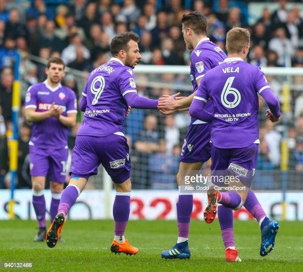 Bolton Wanderers' Adam Le Fondre celebrates scoring his side's first goal with Reece Burke during the Sky Bet Championship match between Leeds United...