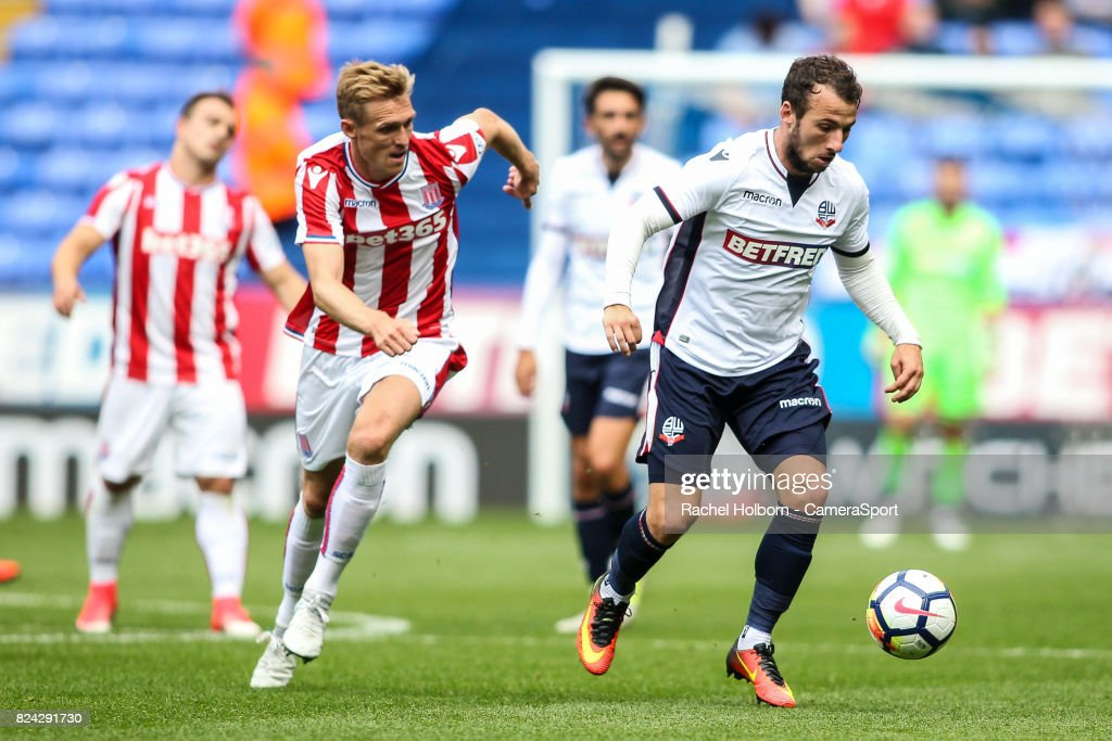 Bolton Wanderers' Adam Le Fondre gets away from Stoke City's Darren Fletcher during the pre-season friendly match between Bolton Wanderers and Stoke City at Macron Stadium on July 29, 2017 in Bolton, England.