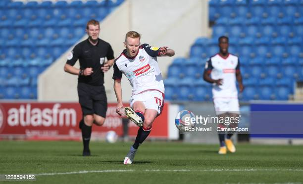 Bolton Wanderers Ali Crawford with a first half shot during the Sky Bet League Two match between Colchester United and Bolton Wanderers at JobServe...