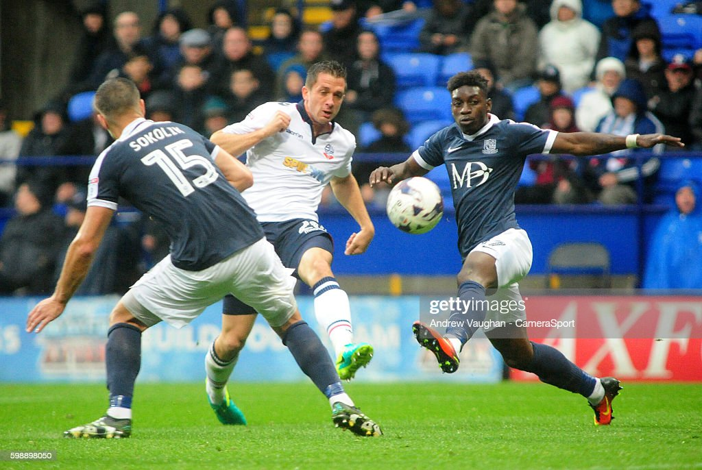 Bolton Wanderers' Andrew Taylor gets a shot away between Southend United's Jakub Sokolik, left and Southend United's Jermaine McGlashan, right during the Sky Bet League One match between Bolton Wanderers and Southend United at Macron Stadium on September 3, 2016 in Bolton, England.