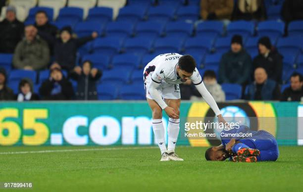 Bolton Wanderers' Antonee Robinson checks on Cardiff City's Junior Hoilett after committing a foul during the Sky Bet Championship match between...