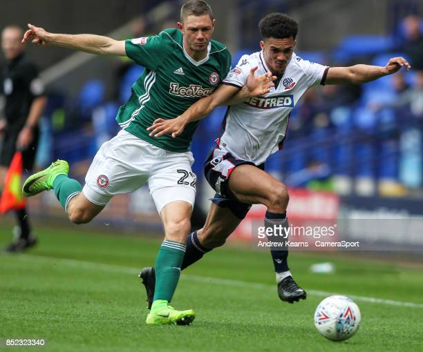 Bolton Wanderers' Antonee Robinson competing with Brentford's Henrik Dalsgaard during the Sky Bet Championship match between Bolton Wanderers and...