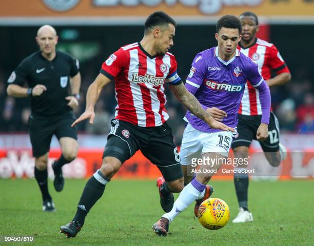 Bolton Wanderers' Antonee Robinson vies for possession with Brentford's Nico Yennaris during the Sky Bet Championship match between Brentford and...