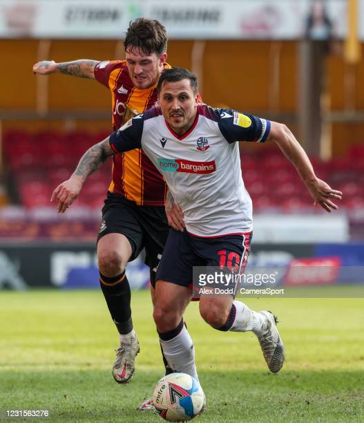 Bolton Wanderers' Antoni Sarcevic battles with Bradford City's Andy Cook during the Sky Bet League Two match between Bradford City and Bolton...