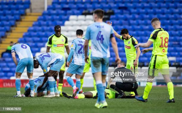 Bolton Wanderers' Aristote Nsiala lies injured after a collision with Coventry City's Callum O'Hare during the Sky Bet League One match between...