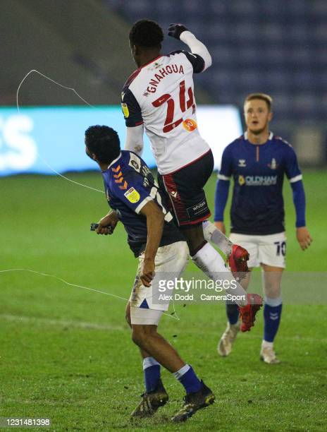 Bolton Wanderers' Arthur Gnahoua battles with Oldham Athletic's Raphael Diarra who squirts his energy gel into the air during the Sky Bet League Two...