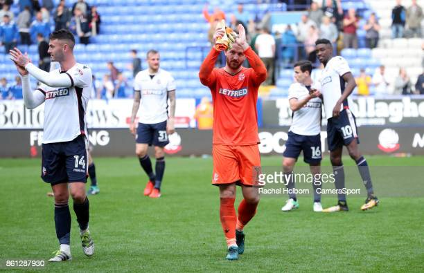 Bolton Wanderers' Ben Alnwick and Bolton Wanderers' Gary Madine celebrate at the end of the game during the Sky Bet Championship match between Bolton...