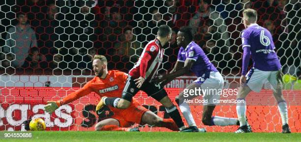 Bolton Wanderers' Ben Alnwick can't keep out Neal Maupay's back heeled shot making the score 20 during the Sky Bet Championship match between...