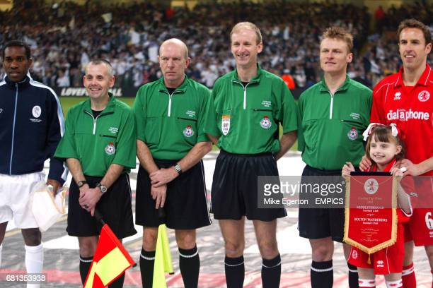 Bolton Wanderers captain Jay Jay Okocha assistant referee's Roy Burton and Ray Gould referee Mike Riley fourth official Michael Jones and...