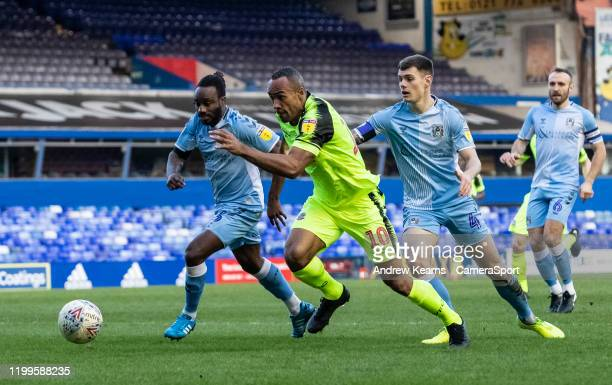 Bolton Wanderers' Chris O'Grady breaks away from Coventry City's Fankaty Dabo and Michael Rose during the Sky Bet League One match between Coventry...