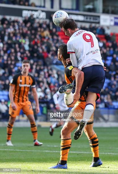 Bolton Wanderers' Christian Doidge competing in the air with Hull City's Tommy Elphick at Macron Stadium on October 27 2018 in Bolton England