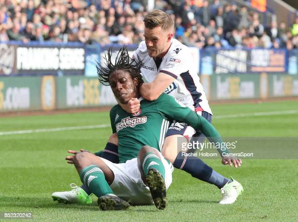 Bolton Wanderers' Craig Noone and Brentford's Romaine Sawyers during the Sky Bet Championship match between Bolton Wanderers and Brentford at Macron...