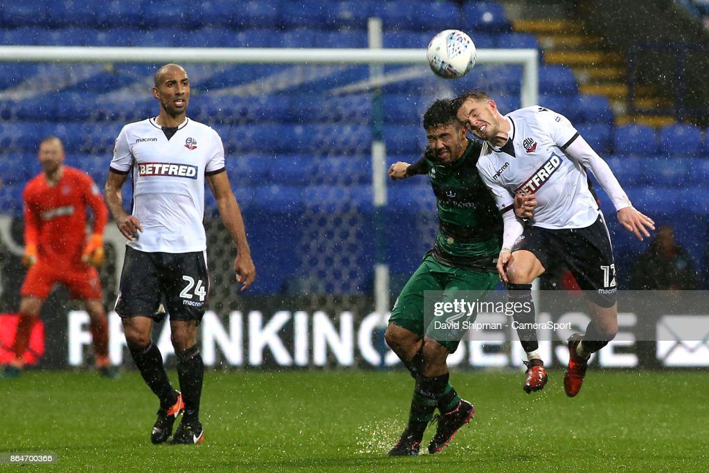 Bolton Wanderers' Craig Noone battles with Queens Park Rangers' Massimo Luongo during the Sky Bet Championship match between Bolton Wanderers and Queens Park Rangers at Macron Stadium on October 21, 2017 in Bolton, England.