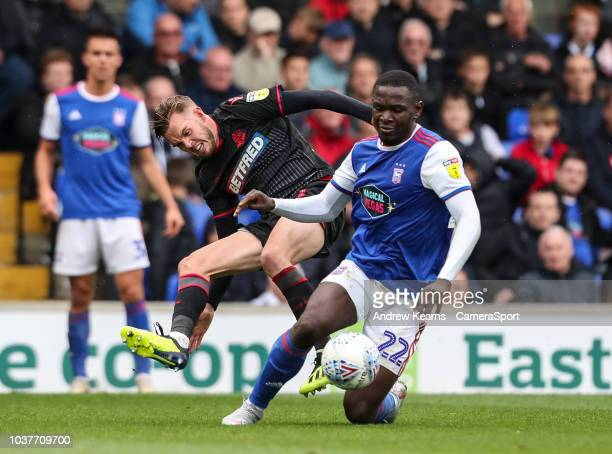 Bolton Wanderers' Craig Noone vies for possession with Ipswich Town's Aristote Nsiala during the Sky Bet Championship match between Ipswich Town and...