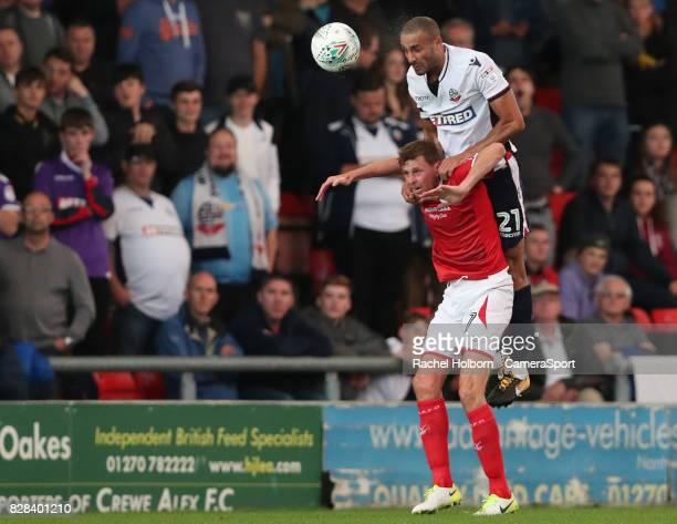 Bolton Wanderers' Darren Pratley and Crewe Alexandra's Chris Porter during the Carabao Cup First Round match between Crewe Alexandra and Bolton...