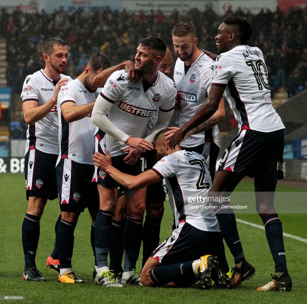 Bolton Wanderers' Darren Pratley is mobbed after scoring his side's first goal during the Sky Bet Championship match between Bolton Wanderers and Queens Park Rangers at Macron Stadium on October 21, 2017 in Bolton, England.