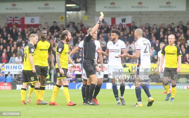 Bolton Wanderers Darren Pratley is shown the yellow card by Ref Graham Scott during the Sky Bet Championship match between Burton Albion and Bolton...