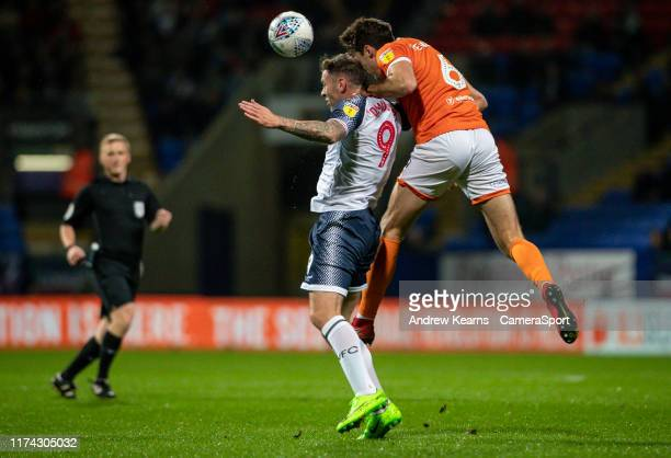 Bolton Wanderers' Daryl Murphy competing with Blackpool's Ben Heneghan during the Sky Bet League One match between Bolton Wanderers and Blackpool at...