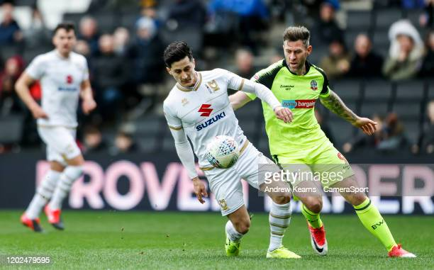 Bolton Wanderers' Daryl Murphy competing with Milton Keynes Dons' Ben Reeves during the Sky Bet League One match between Milton Keynes Dons and...